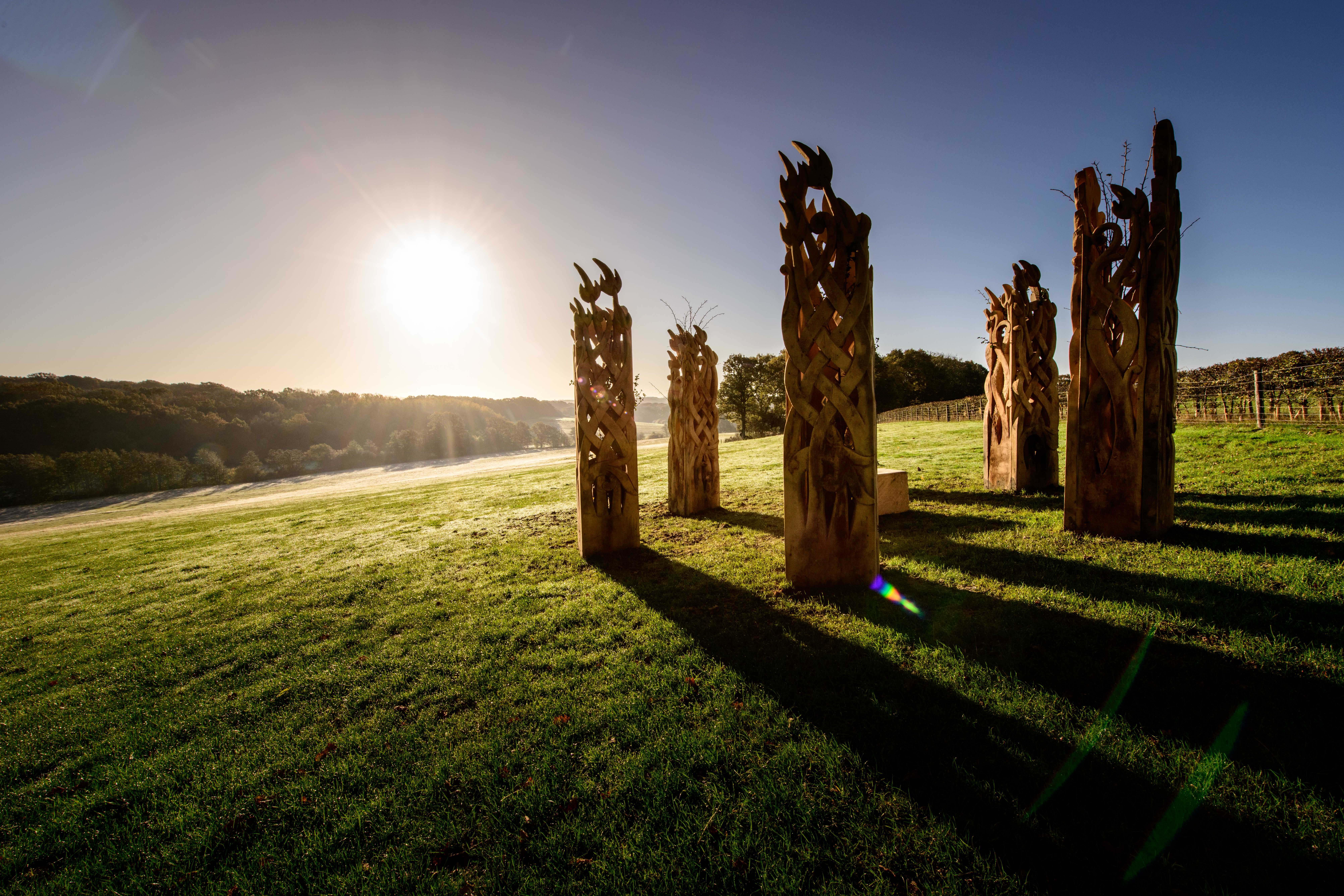 Wooden henge sculptures on the 1066 Country Walk at Westfield. Sculptures by Keith Pettit, photo by Jim Holden.