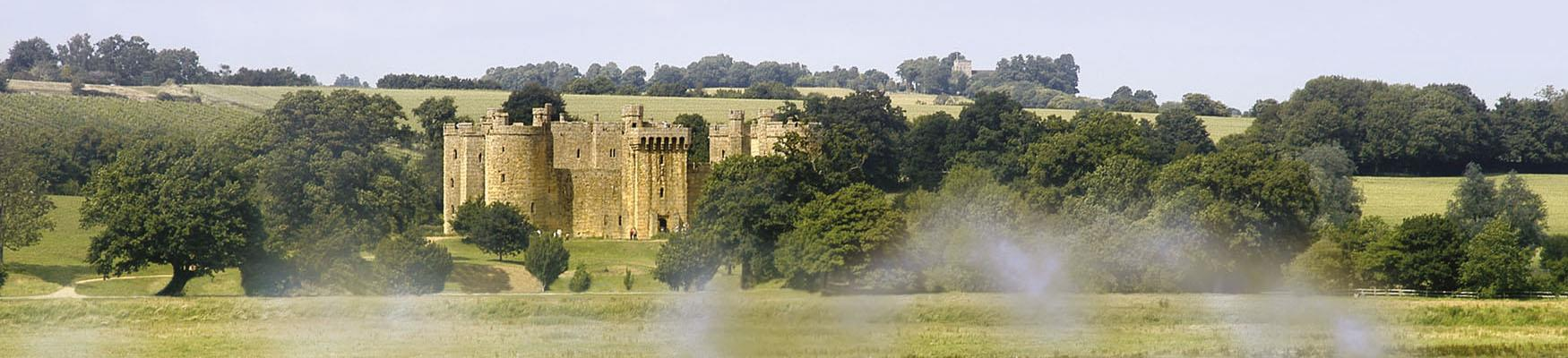 Bodiam Castle with steam train in foreground