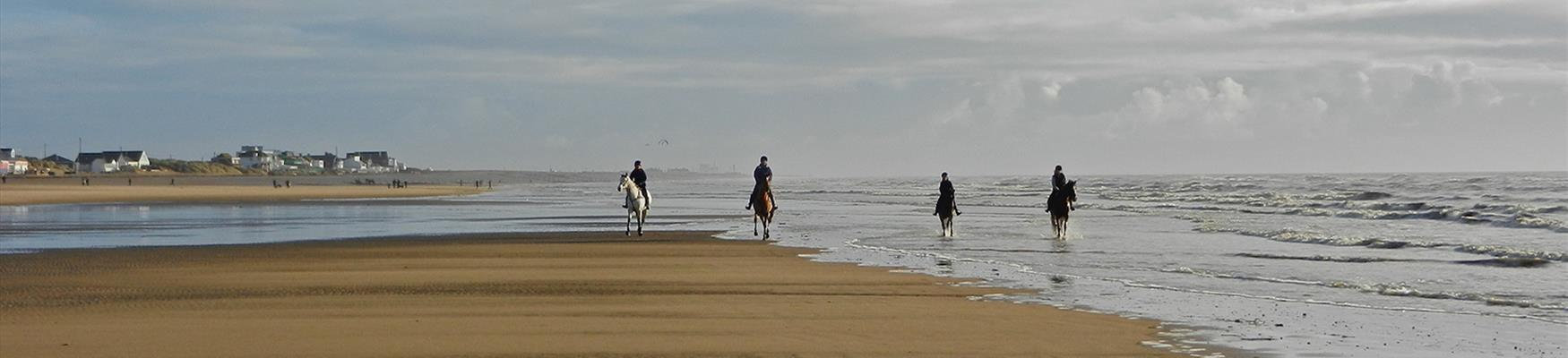 Horse riders on Camber beach