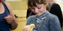A young girl holding a chick at the Rare Breeds Centre