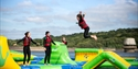 Teenagers playing at Bewl Water's Aqua Park in Lamberhurst, Kent.