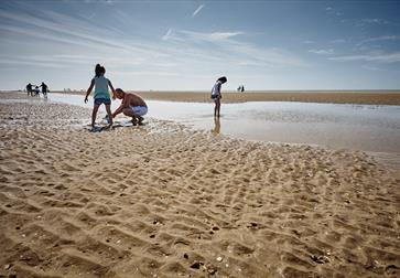 Children playing at low tide on Camber Sands