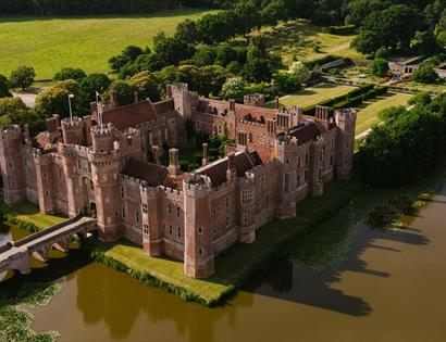 Bridge, moat and gardens at Herstmonceux Castle.